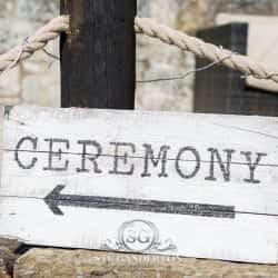 sign pointing the way to the ceremony