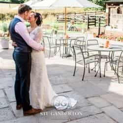 a bride and groom share an intimate moment at tower hill barns llangollen