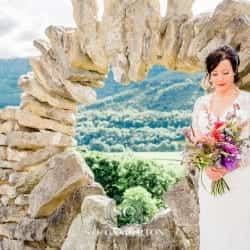 beautiful bridal portrait by a stome wall at tower hill barns llangollen