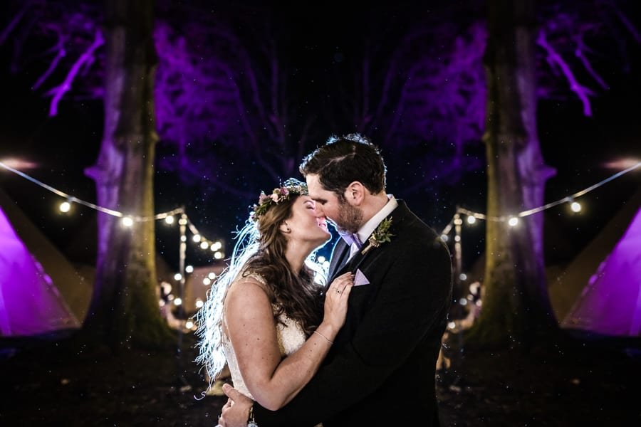 portrait of a bride and groom at their tipi wedding