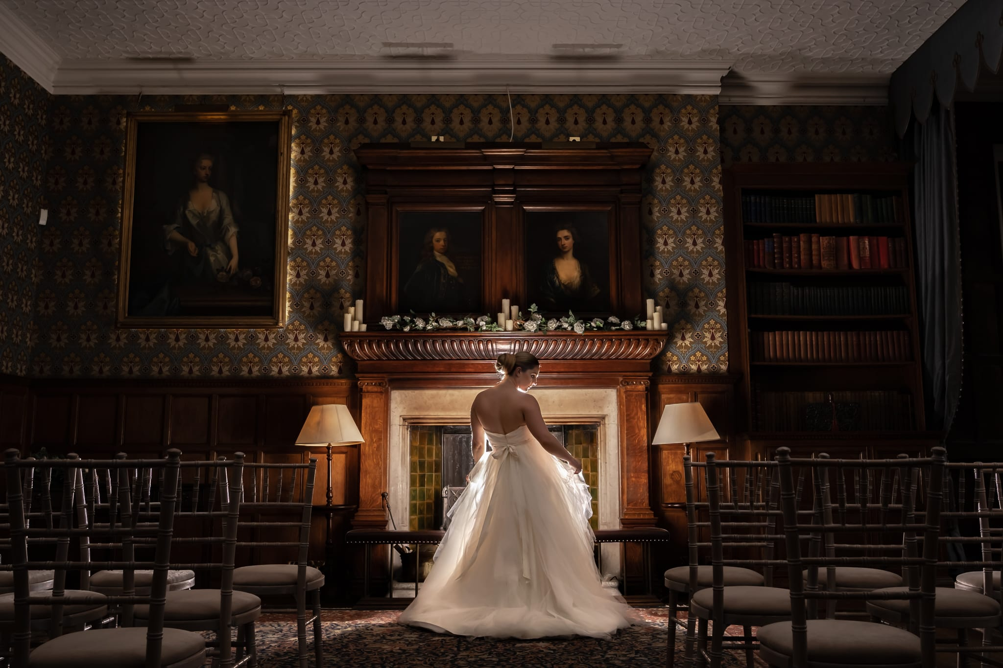dramatic picture of a bride in front of a fireplace at hodsock priory