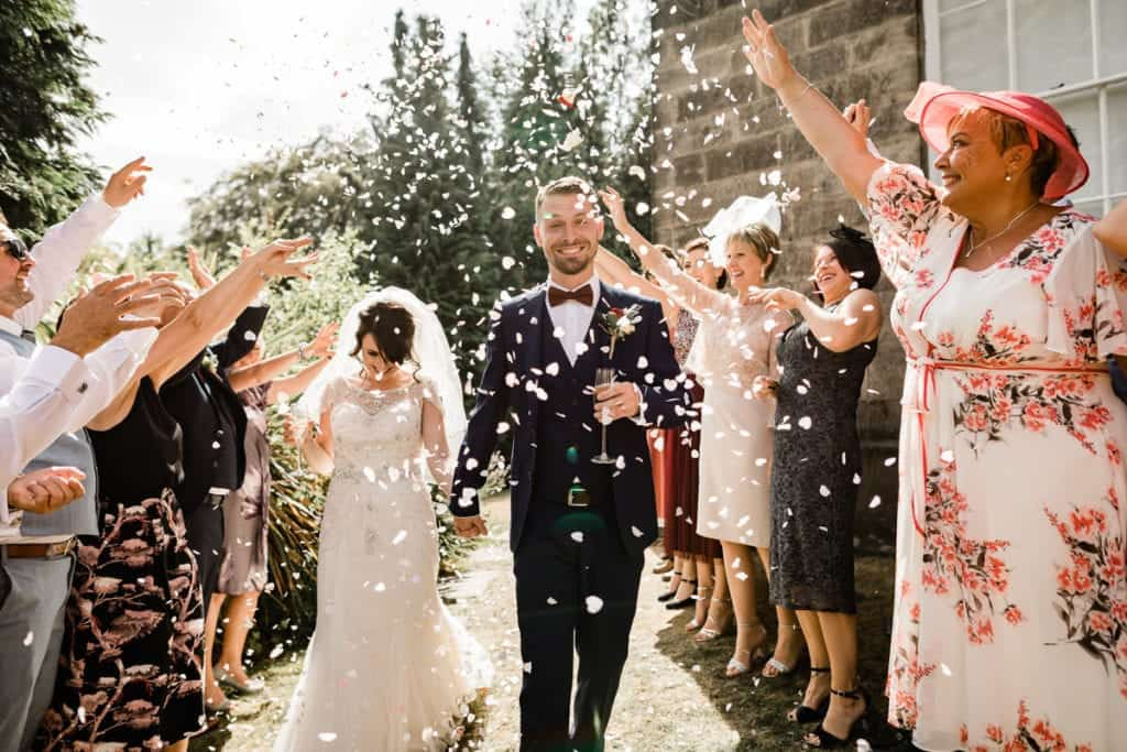 confetti is thrown at a couple after they have got married